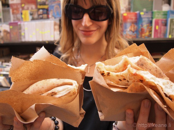Girl with street pizza from Bellini in Centro Storico in Naples