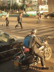 Scooter stopping at intersection in Kunming