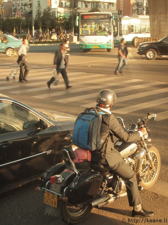 Scooter stopped at intersection in Kunming