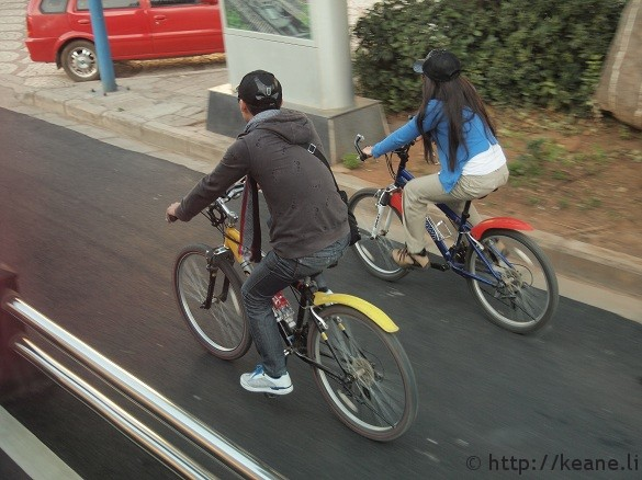 A couple biking in Lijiang