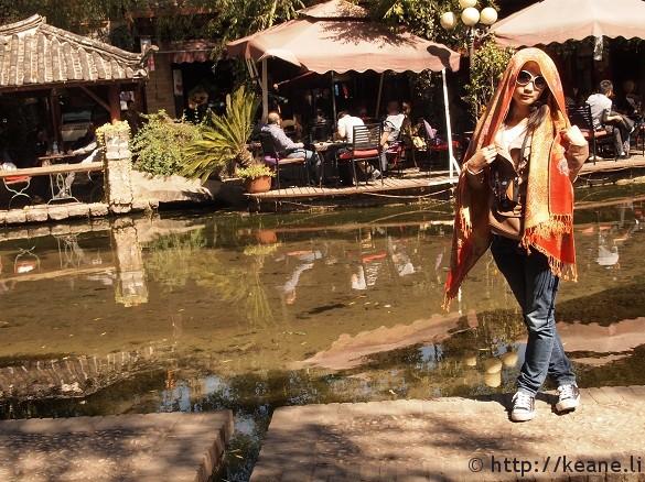 Girl poses in Shu He Ancient Town in Lijiang