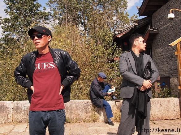 Three guys dressed three different ways on Qinglong Bridge in Shu He
