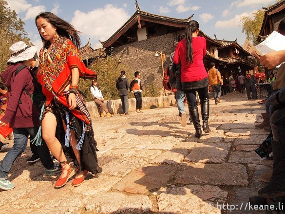 Energetic shot of a woman in flowing clothes as she struts across Qinglong Bridge in Shu He