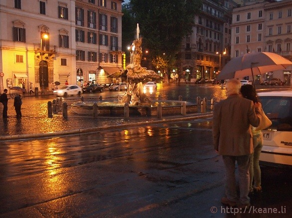 Piazza Barberini and the Fontana del Tritone in the Rain