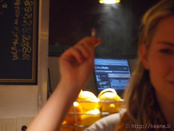 Girl smoking a cigarette in a jazz lounge in Centro Storico in Naples