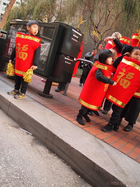 Kids dressed as firecrackers on Market Street before the Chinese New Year parade