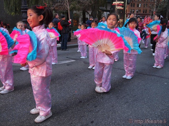 Fan girls smiling in Chinese New Year parade in San Francisco