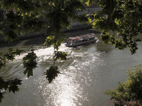 Rome - Boat in the glistening Tevere river