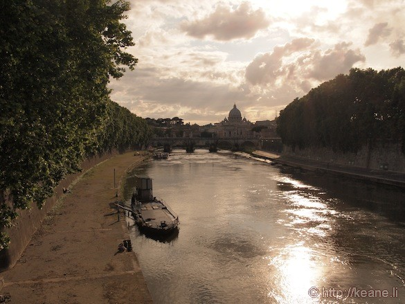 Rome - Beautiful Tevere river and boat at sunset