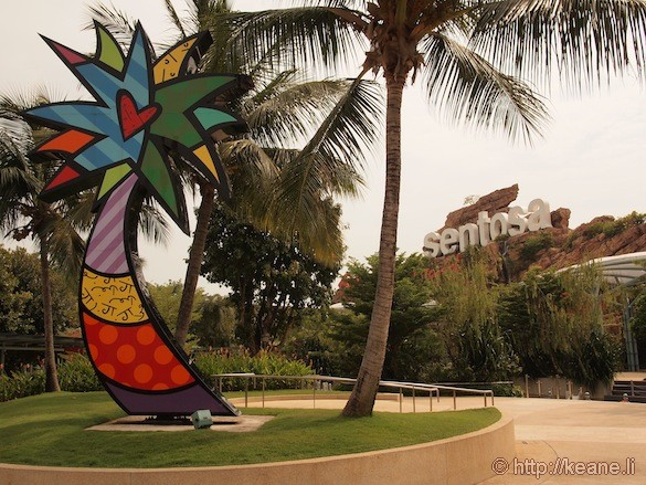 Sentosa Island in Singapore - Colorful tree and Sentosa sign