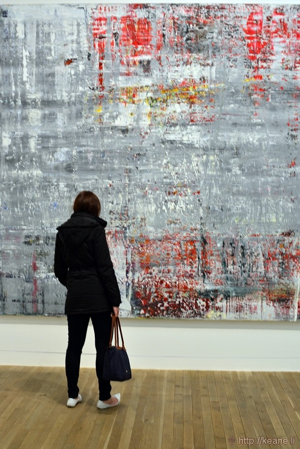 Woman Admires Art in Tate Modern