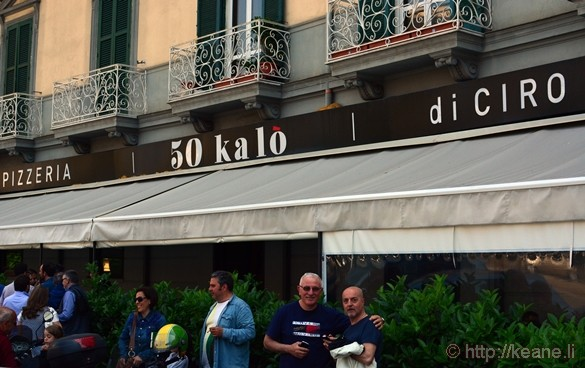 Men Posing in Front of Pizzeria 50 Kalò di Ciro Salvo