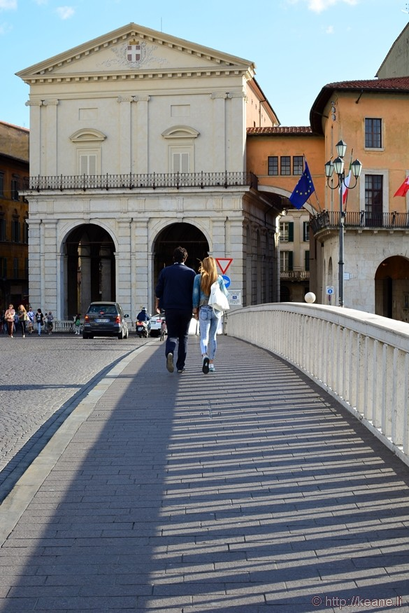 Couple Walking Across the Ponte di Mezzo in Pisa