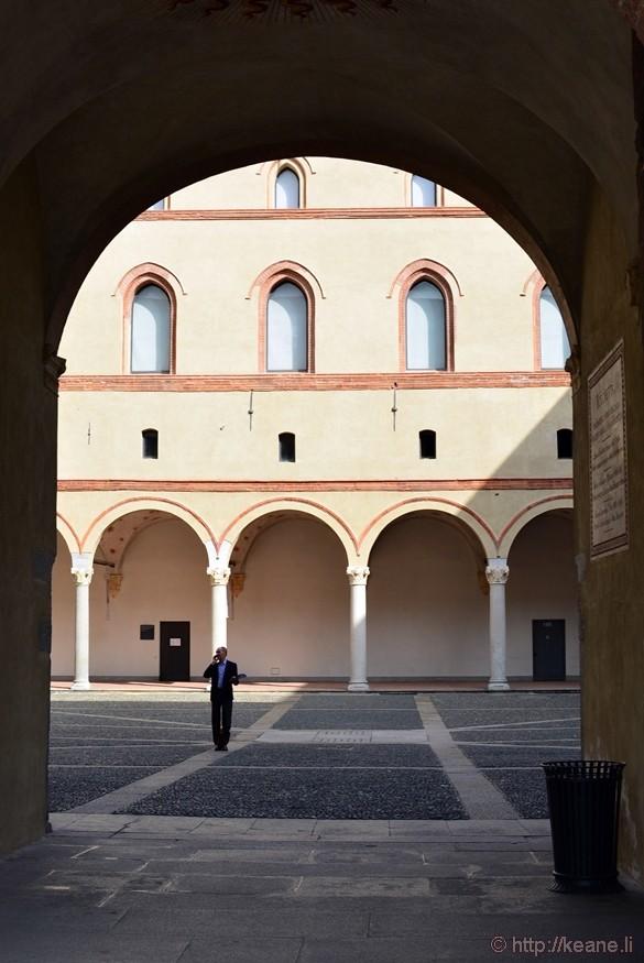 Man on Phone in Courtyard in Castello Sforzesco in Milan