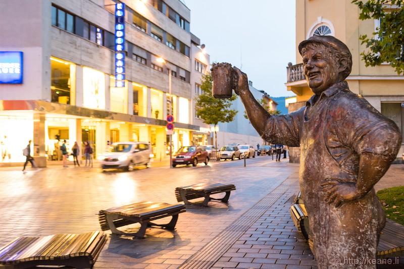 Statue of a Drinking Man in Villach, Austria