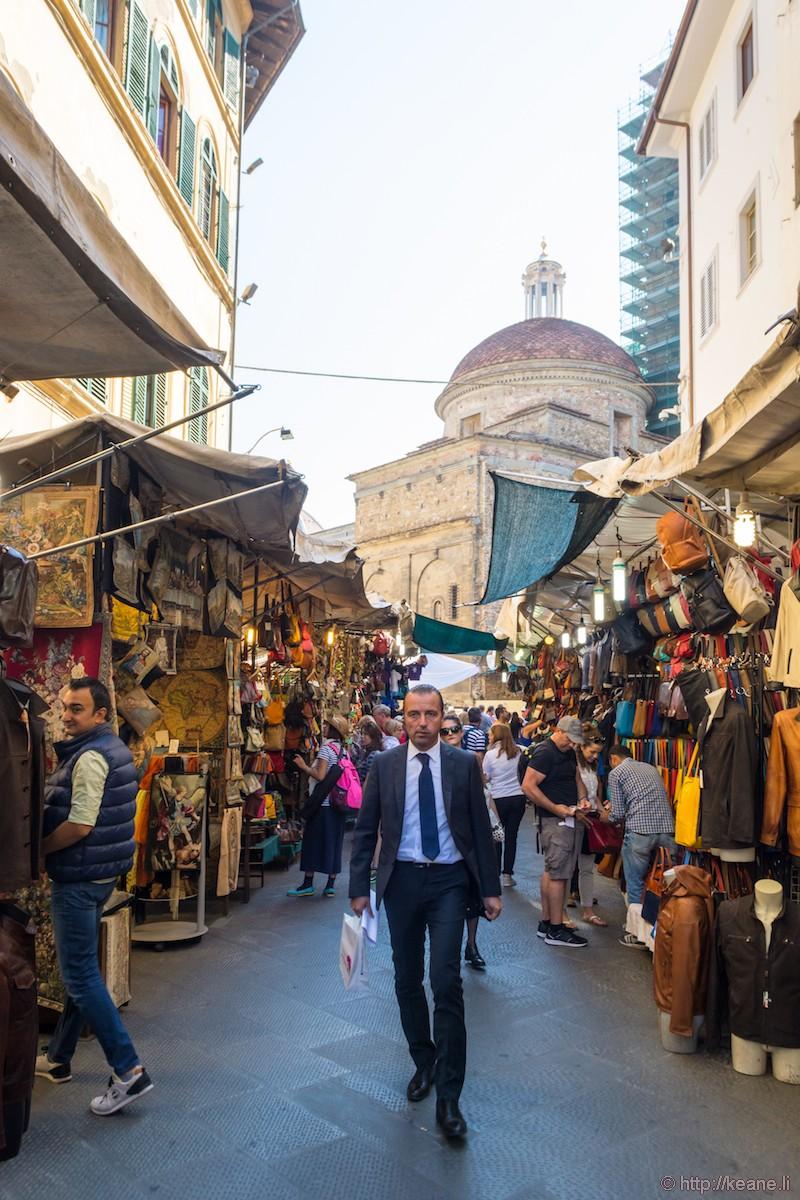 Man Walks Through the Mercato San Lorenzo